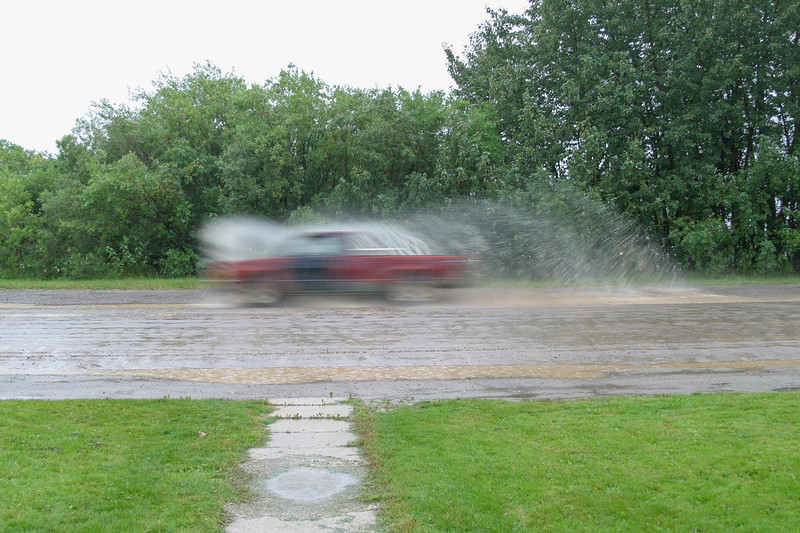 Vehicle going through puddle on Revillon Road 2004 September 11