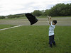 David Hunter flying garbage kite in heavy wind. 2001 June 19