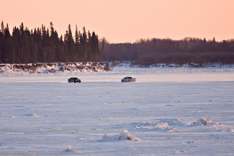 Vehicles on the Moose River as seen from Moosonee, Ontario 2007 December 9.