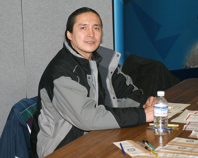 Giles Akiwenzie from Probation and Parole 2005 February 15th at Career Fair held at Northern College in Moosonee. 2005 February 15