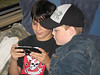David Hunter and Colby Tozer playing PSP on the train.