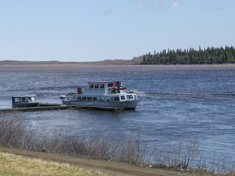 Tour boat Polar Princess at anchor in Moosonee on the Moose River.