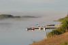 Looking up the Moose River on a foggy morning from newly cleared area past docks. 2004 August 30