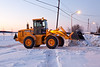 Loader clearing staf lawyer's driveway at Keewaytinok Native Legal Services 2011 December 16. Blurry shot before sunrise.