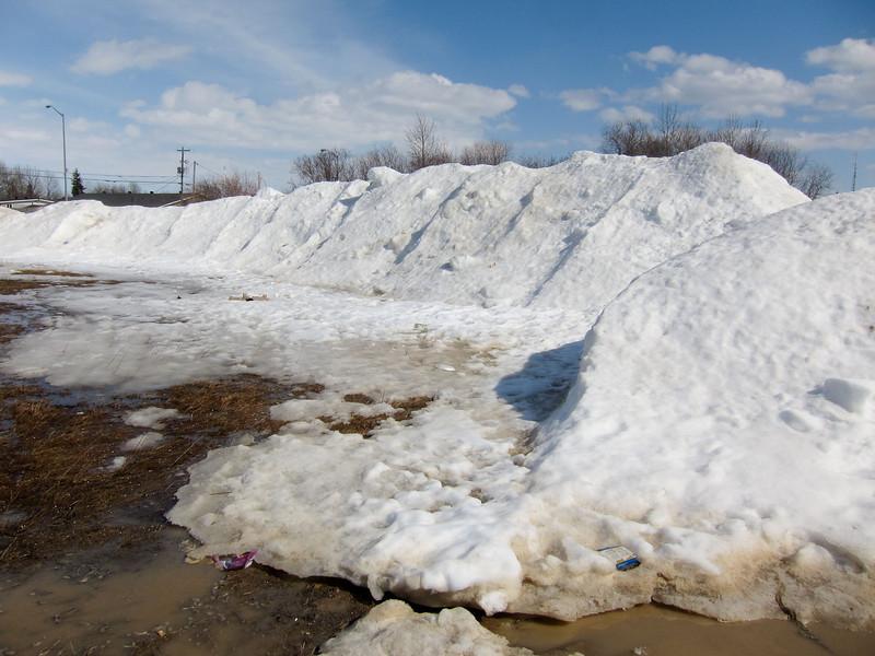 Snow pile at Moosonee Office Building parking lot