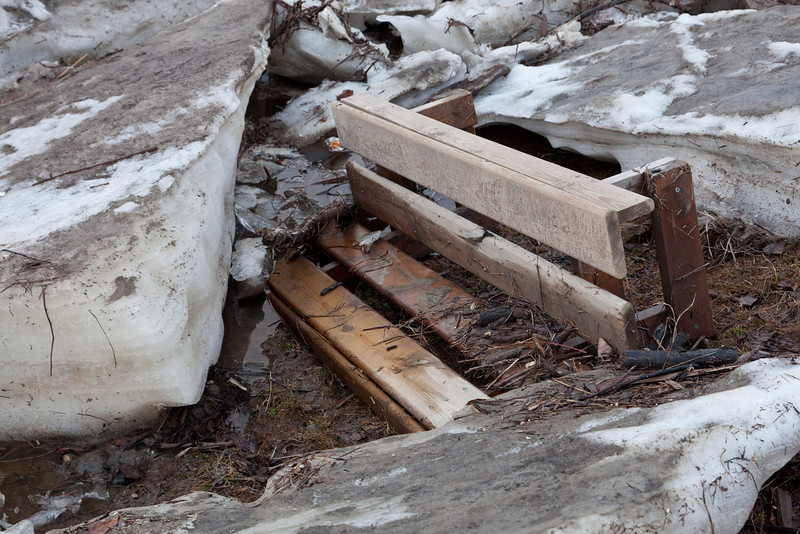 Bench from a canoe that came along with the ice.