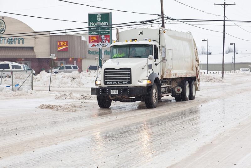 Icy streets in Moosonee 2011 February 18th. Town of Moosonee garbage truck on First Street.