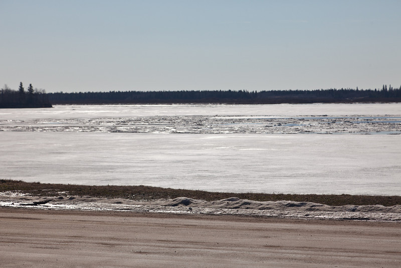 Looking across the Moose River 2011 April 29th, Revillon Road in the foreground.