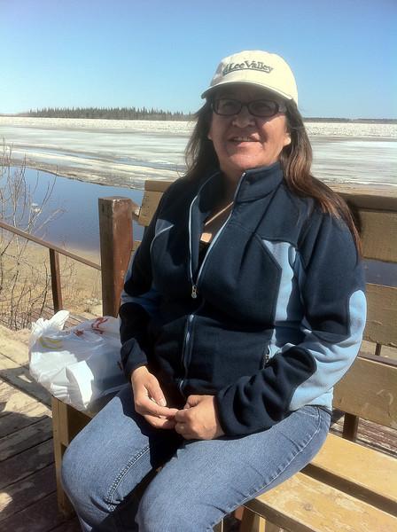 Denise Metatawabin sitting above Two Bay docks.