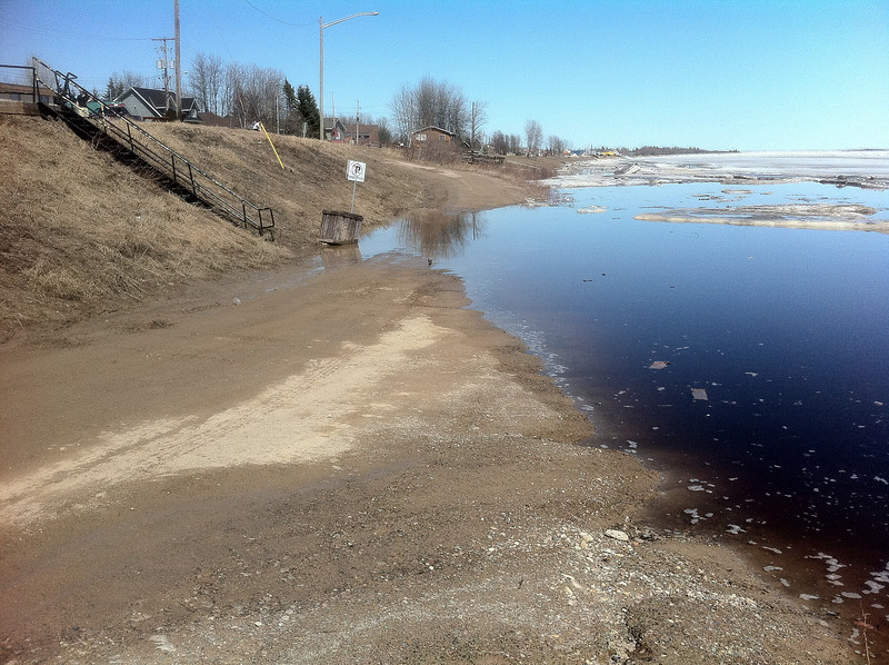 Public docks at 2:00 pm April 30th 2011. Road crossed by water.