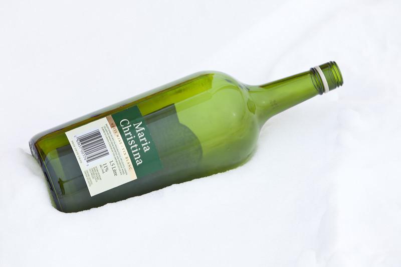 Wine bottle in the snow.