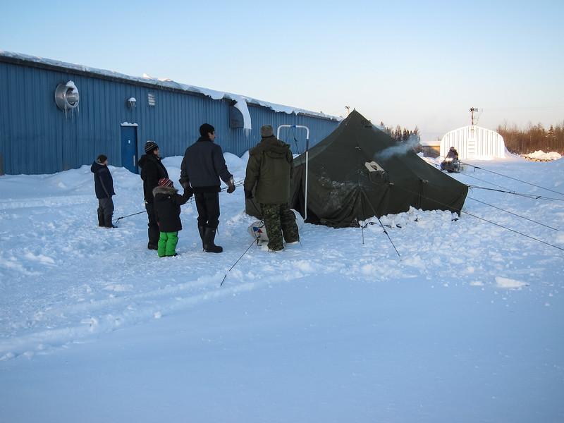 Soldiers and communtiy members outside Moosonee Arena.
