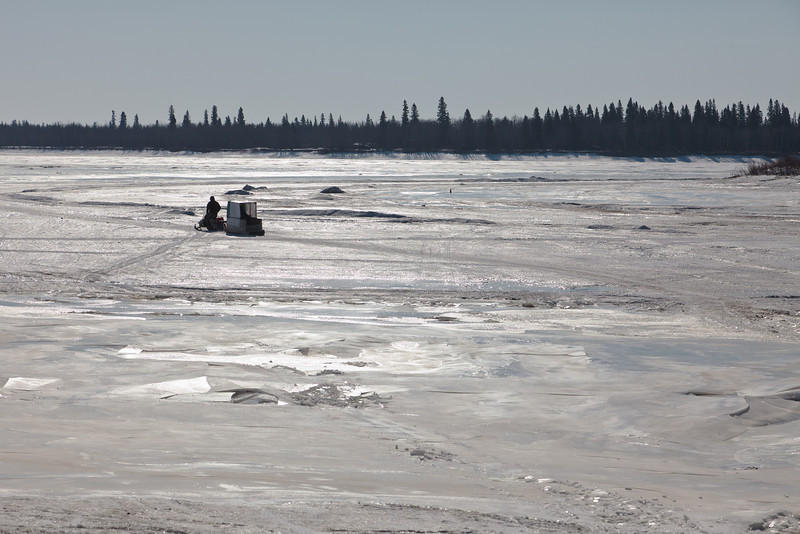 Snowmobile taxi leaving for Moose Factory