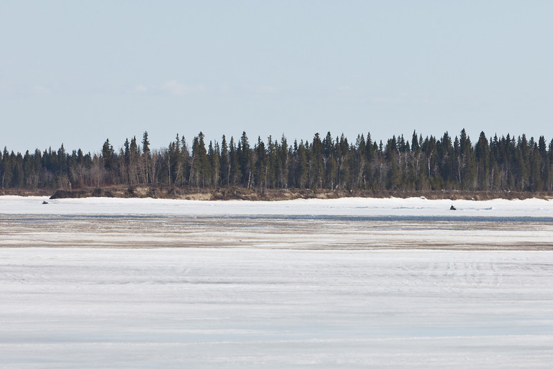 Two snowmobiles on the Moose River 2011 April 22nd.