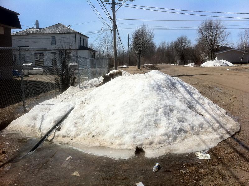Snow along Bay Road by Moosonee Office Building
