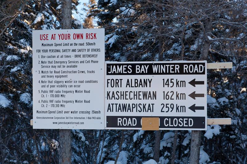 Signs on winter road that runs north from Moosonee, Ontario.