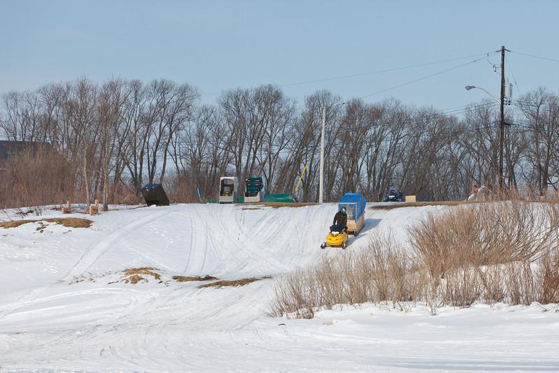 Snowmobile taxi coming down McCauley's Hill