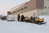 Military personnel with snowmobiles at Northern Store in Moosonee, Ontario.