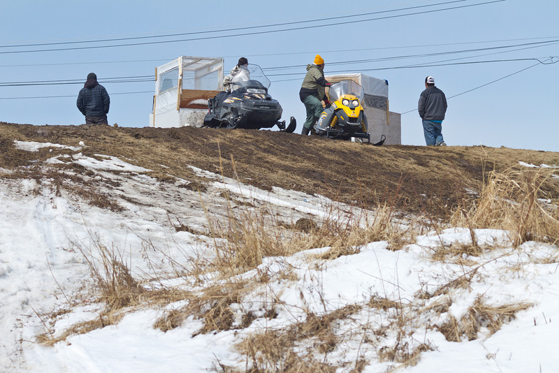 Snowmobile activity on the Moose River at Moosonee, Ontario 2011 April 21st including taxis running between Moosonee and Moose Factory using sleds.