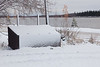 Garbage box covered with snow with Butler Island in background.