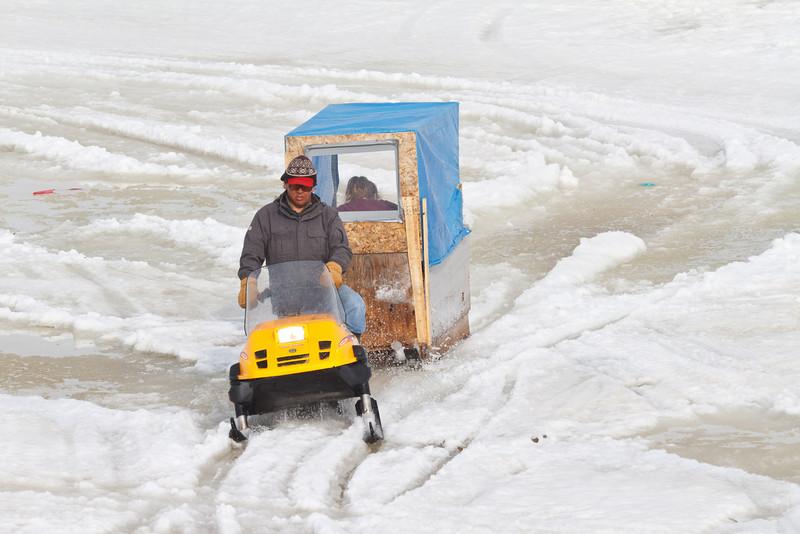 Snowmobile taxi arriving in Moosonee 2011 April 10th.