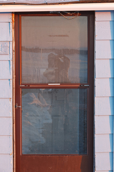 Photographer on a chilly April morning reflected in his doorway 2011 April 14th minus 22 wind chill