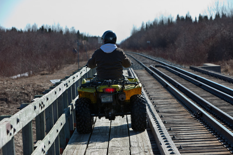 ATV on railway bridge