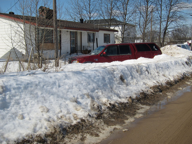 Truck buried in snow on Cotter Street.
