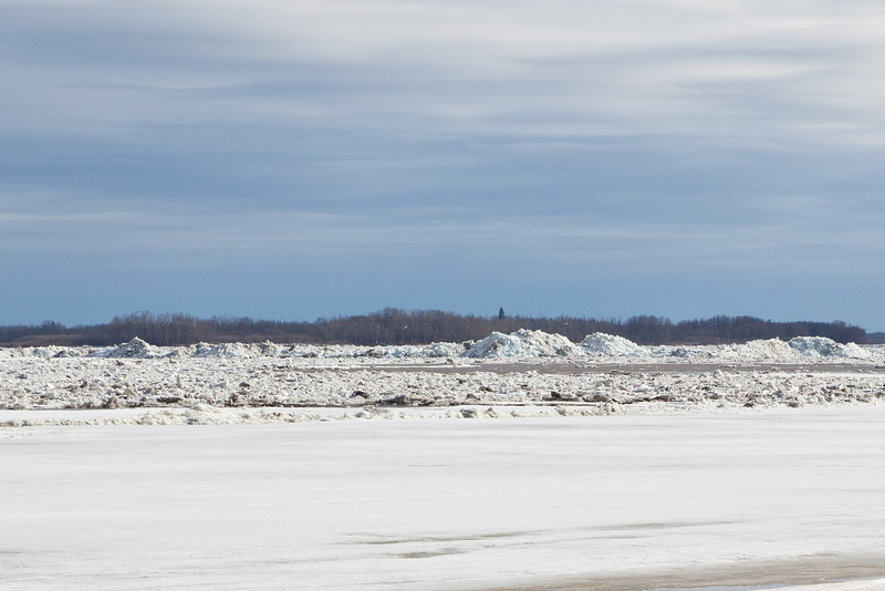 Looking across and up the Moose River. Note mounds of ice.