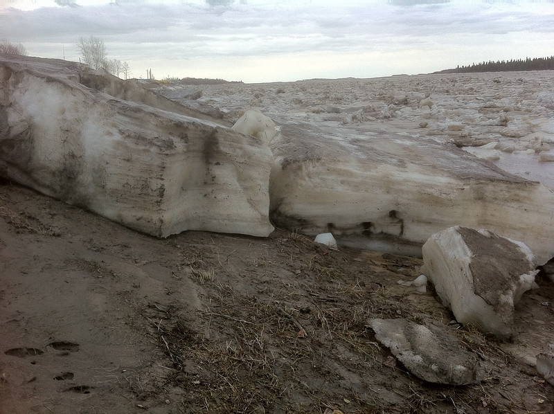Ice piled on shore.
