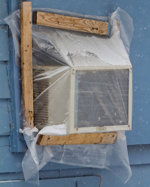 Air conditioner on CLW window awaits warmer days.