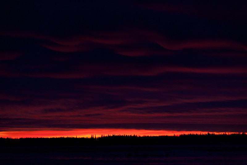 Fiery skies before sunrise on 2011 December 2nd. Looking east from Moosonee, Ontario across the Moose River.