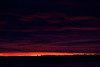 Fiery skies before sunrise on 2011 December 2nd. Looking east from Moosonee, Ontario across the Moose River.