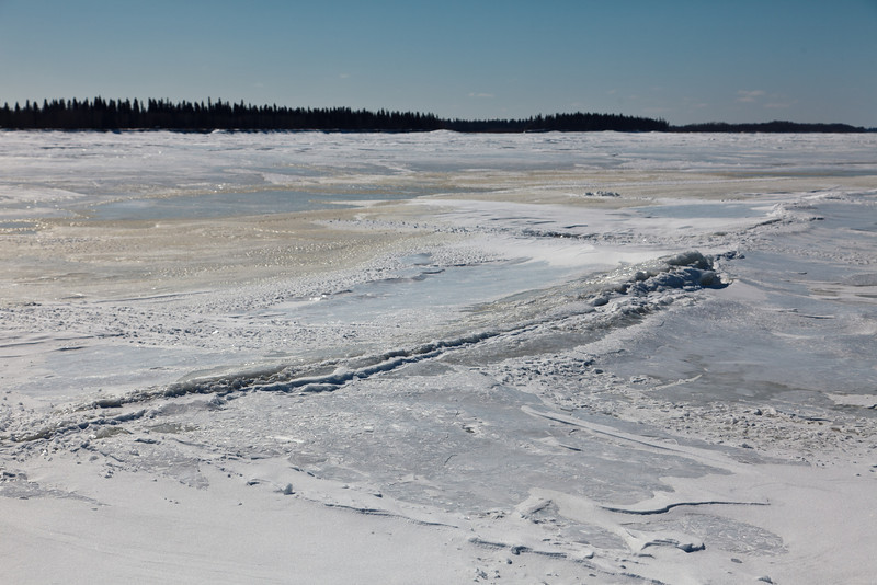 Wind blown snow on the ice of the Moose River at Moosonee