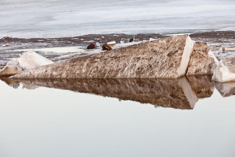 Ice at an angle near public docks.