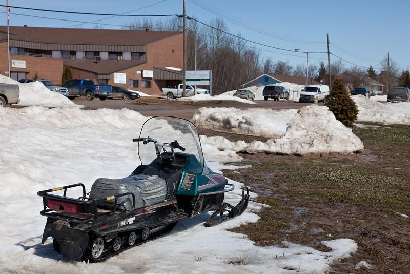 Snowmobile parked beside Revillon Road 2011 Apri l12
