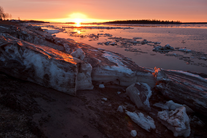 Looking down the Moose River at sunrise 2011 May 1 showing ice piled on shore.