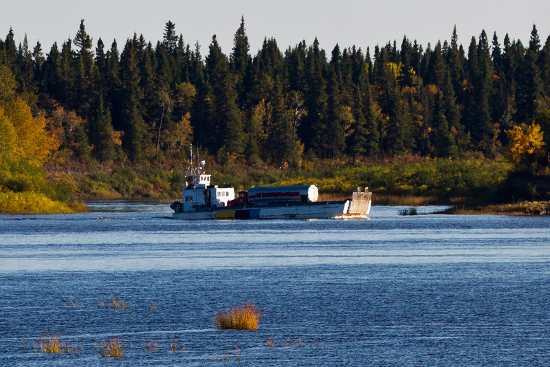 Ontario Northland barge Manitou Island II travelling on the Moose River between Moosonee and Moose Factory, Ontario. Seen here turning as she exits the Gutway from Moose Factory.