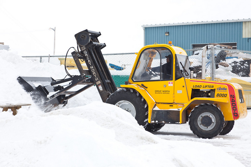 Great North Builders Supplies forklift with snow moving attachment.