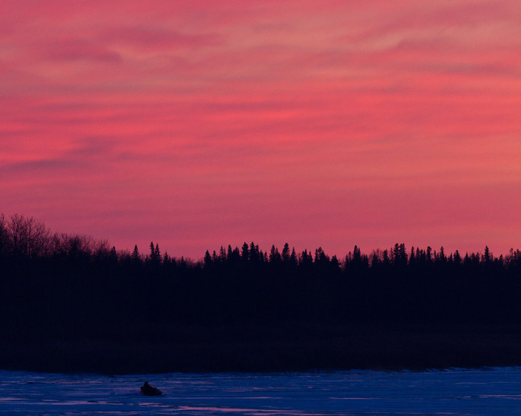 Snowmobiles on the Moose River at sunset 2011 Nov 28