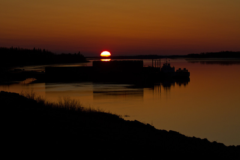 Sunrise over barges