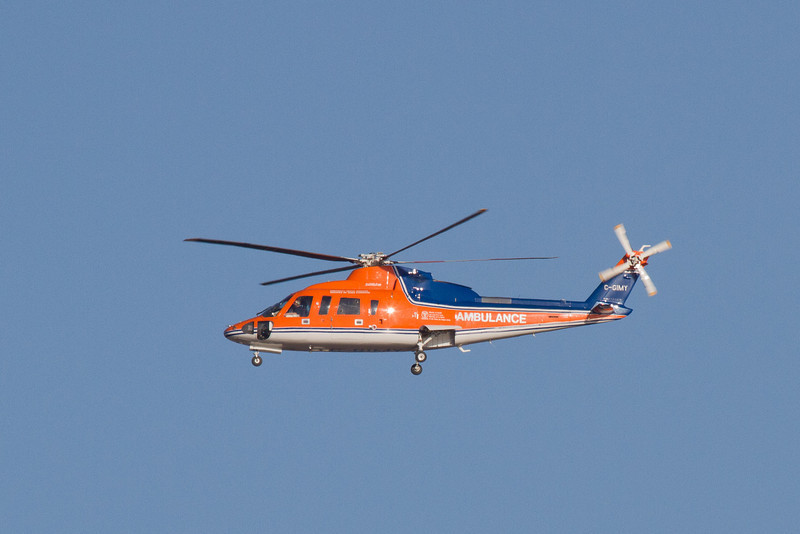 Ambulance helicopter over the Moose River 2011 May 5. C-GIMY.