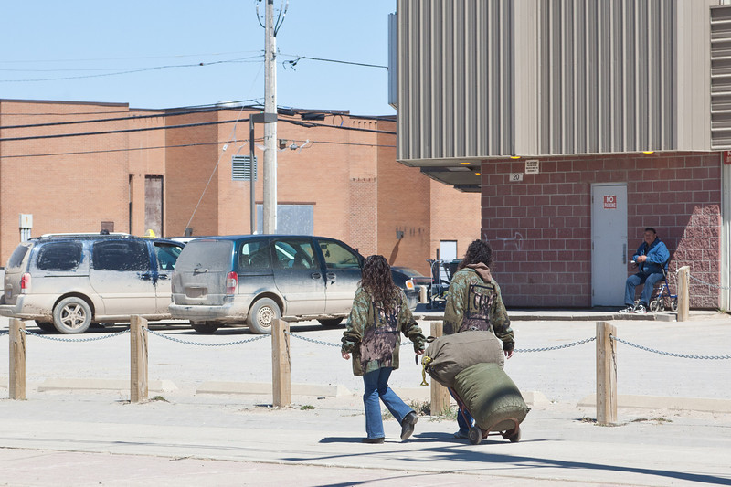 Musicians with luggage on First Street. (Green River Revival)