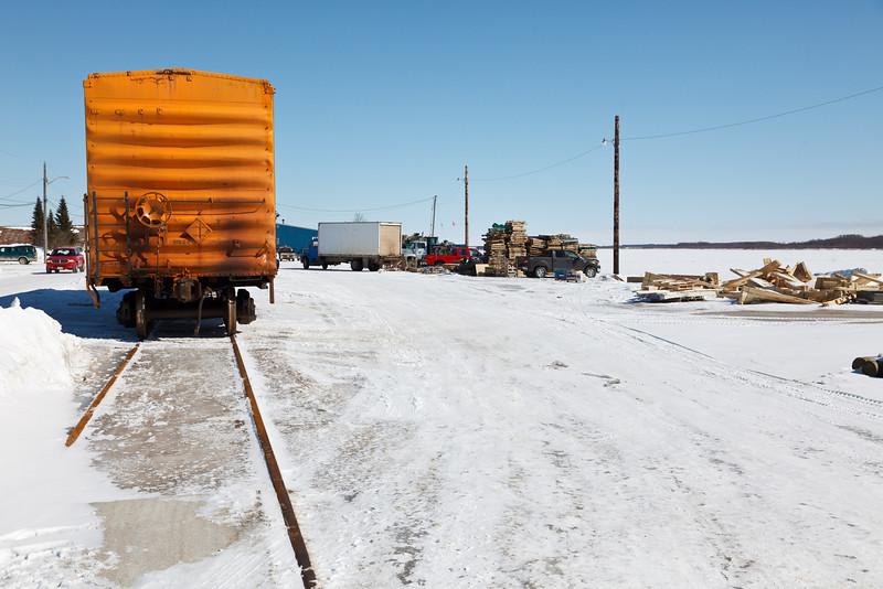 Trucks and boxcars along the Moose River