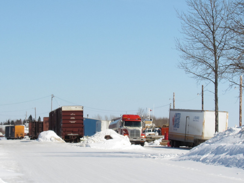 Truck and boxcars on Revillon Road