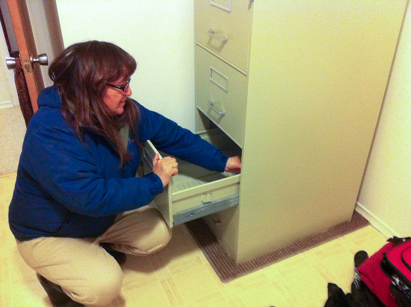 Denise cleaning her second hand filing cabinet.