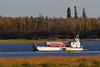 Ontario Northland barge Manitou Island II travelling on the Moose River between Moosonee and Moose Factory, Ontario.