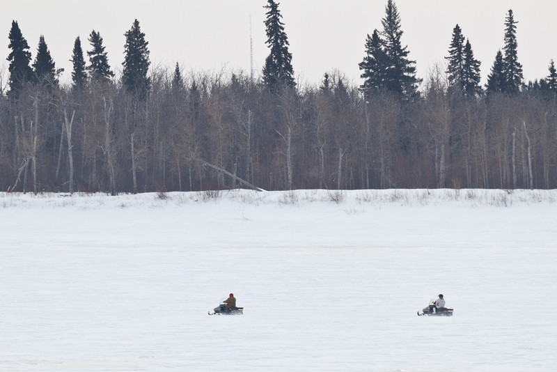 Snowmobiles in front of Charles Island