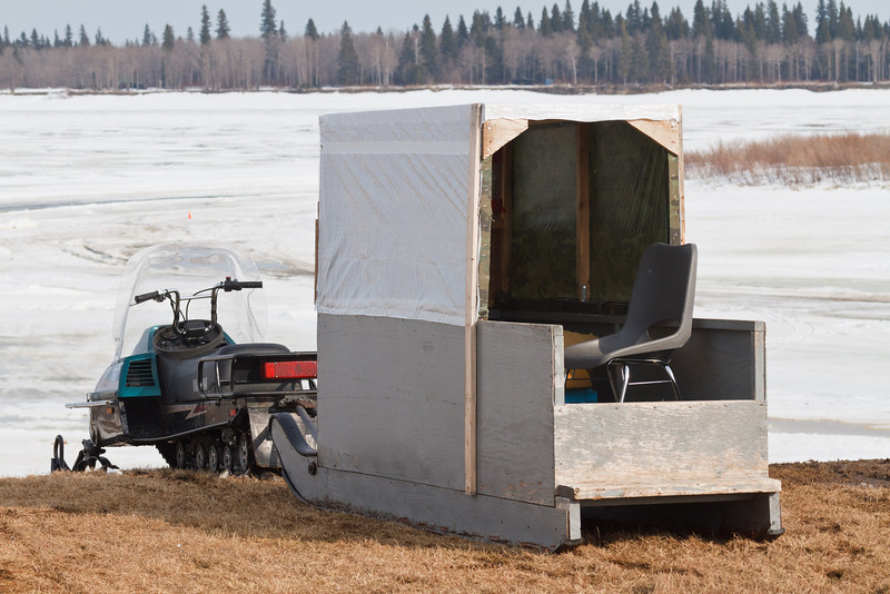 Snowmobile taxi waiting for passengers in Moosonee.