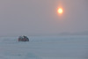 Taxi on the way to Moose Factory from Moosonee on a cloudy morning with light snow